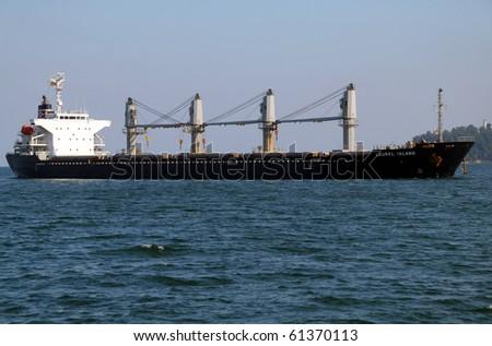 VARNA, BULGARIA - SEPTEMBER 19: Cargo ship LAUREL ISLAND (Year Built: 2005, Flag: Panama) sails into Port of Varna-West to deliver 17 790 tons of sugar on September 19, 2010 in Varna, Bulgaria. - stock photo