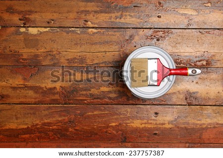 varnishing old wooden plank floor - stock photo