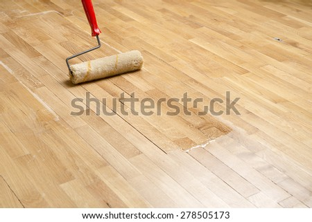 Varnishing Parquet with Copy Space  - stock photo