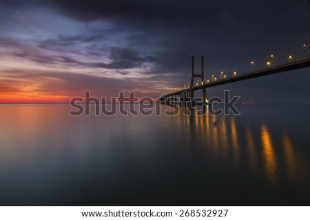 Vasco da Gama bridge over tagus river in Lisbon at dawn - stock photo