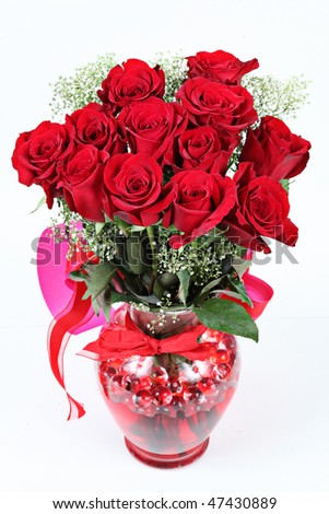 Vase of red roses for Valentines Day - stock photo