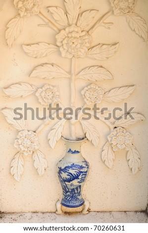 vase on wall - stock photo