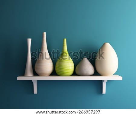 vase on white shelf with blue wall - stock photo