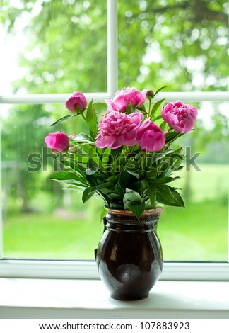 vase with peonies - stock photo