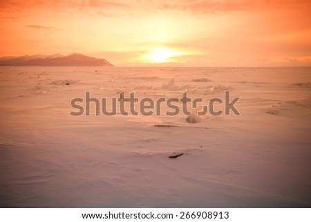 Vast snowy wilderness. Lake Baikal in winter. Toned. - stock photo