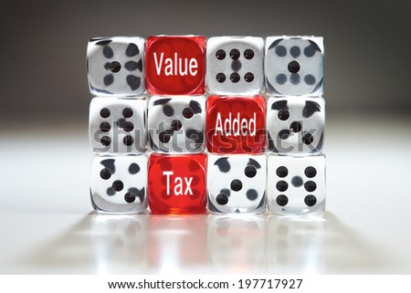 VAT concept, three red dice with Value, Added and Tax in a wall of clear dice. - stock photo