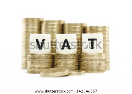 VAT (Value Added Tax) on Stacks of Gold Coins with a White Background - stock photo