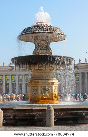 Vatican. A fountain before St. Peter's Cathedral - stock photo