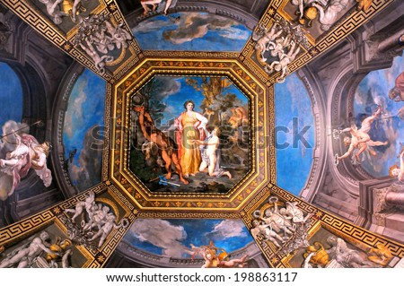VATICAN - APRIL 29, 2014: Detail of the ceiling in one of the galleries of the Vatican Museums - stock photo