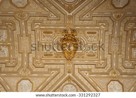 VATICAN CITY, ITALY - MARCH 05, 2012: A golden ceiling of the S. Pietro Basilica - stock photo