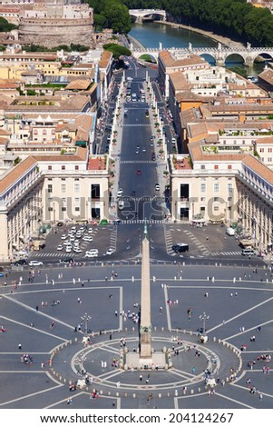 VATICAN CITY - JULY 01: St Peters Square on July 01, 2014 in Vatican City. It is a massive plaza located directly in front of St Peters Basilica, the papal enclave surrounded by Rome. - stock photo