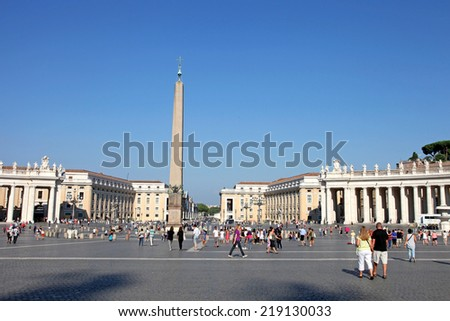 VATICAN CITY, VATICAN - JULY 19, 2014: People at Saint Peter's Square. St. Peter's Square is a massive plaza located directly in front of St. Peter's Basilica in the Vatican City - stock photo