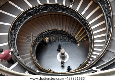 VATICAN CITY, VATICAN STATE - MARCH 15, 2016: People descend the modern double helix staircase designed by Giuseppe Momo in 1932, Vatican Museums - stock photo