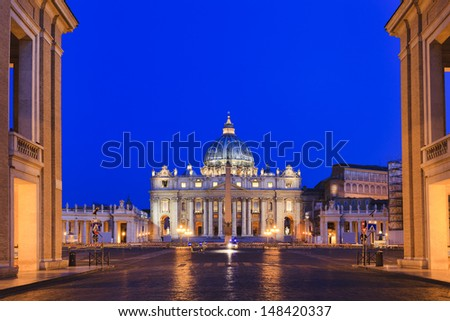 Vatican Italy Rome state of religion Christianity landmark biggest cathedral St Peter and square entrance from city street at sunrise highlighted lights and illumination - stock photo