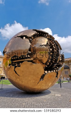 VATICAN - SEPTEMBER 18: The Sphere within a Sphere, a bronze sculpture by Italian sculptor Arnaldo Pomodoro in the courtyard of Vatican Museum on September 18, 2012 in Vatican. - stock photo