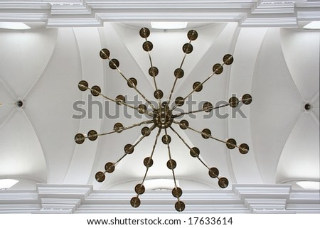Vault in old church with brass chandelier. - stock photo