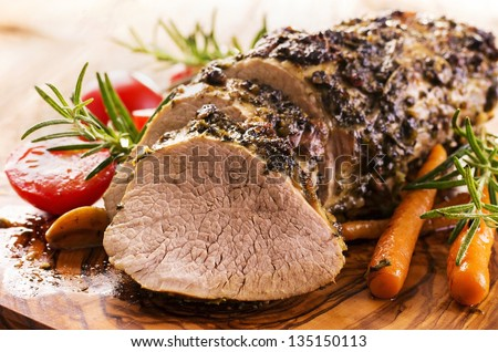 veal roast with vegetables - stock photo