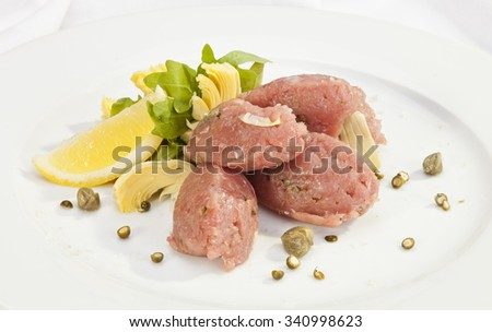 Veal steak tartar with caper and fresh artichoke - stock photo