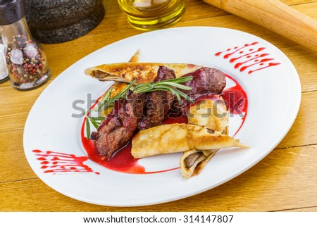 Veal tenderloin and pancakes with mushrooms - stock photo