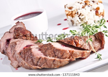 Veal tenderloin stuffed with cherries and rice - stock photo