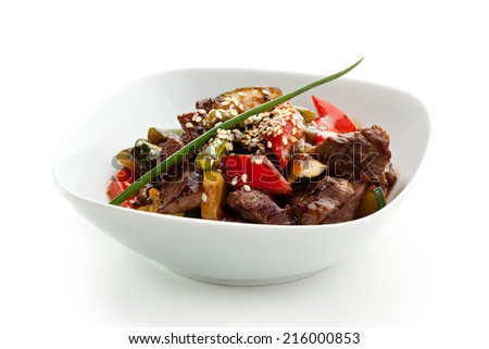 Veal with Vegetables and Piquant Sauce - stock photo