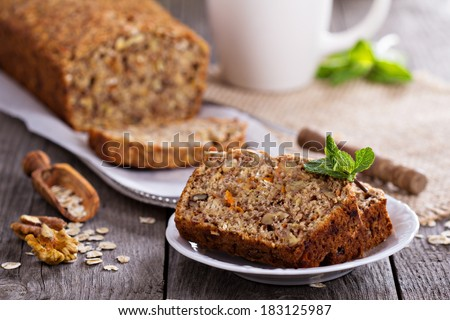 Vegan banana carrot bread with oats and nuts - stock photo
