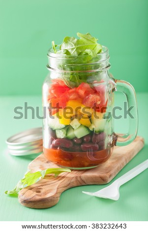 vegan bean vegetable salad in mason jars - stock photo