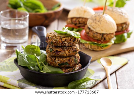 Vegan burgers with  beans and vegetables served with spinach - stock photo