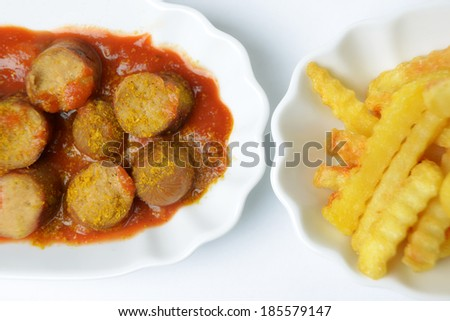 vegan curry sausage with french fries - stock photo