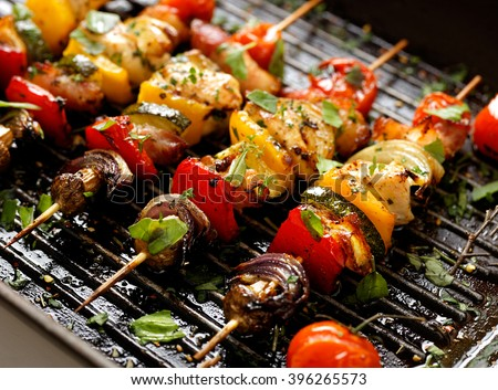 Vegetable and meat skewers in a herb marinade - stock photo