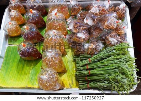 Vegetable and seafood sauce sell in the market. - stock photo