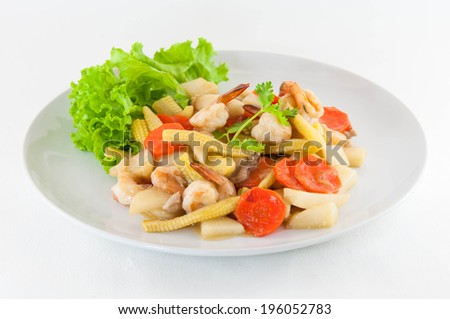 Vegetable and shrimp stir-fry dishes on white background - stock photo