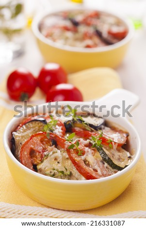Vegetable casserole with cheese on white background - stock photo