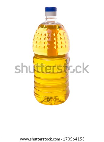 Vegetable cooking oil in a plastic container over white background. - stock photo