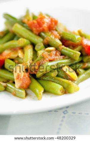 Vegetable food with green beans, tomatoes and garlic - stock photo
