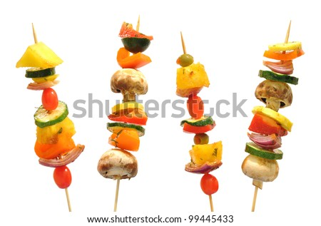 Vegetable kebabs with peppers, mushrooms, zucchini, onions, tomatoes, and pineapple - stock photo