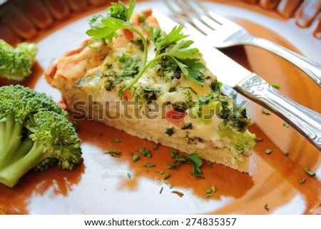 Vegetable pie with broccoli, cheese and fresh parsley - stock photo