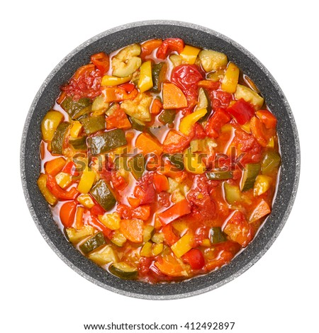 Vegetable ragout. Stewed zucchini, tomatoes, carrot and pepper.                                                          - stock photo