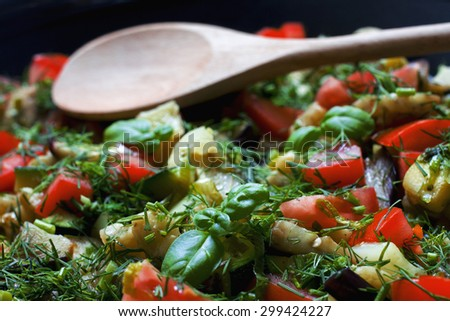 Vegetable Ratatouille in frying pan with wooden spoon - stock photo