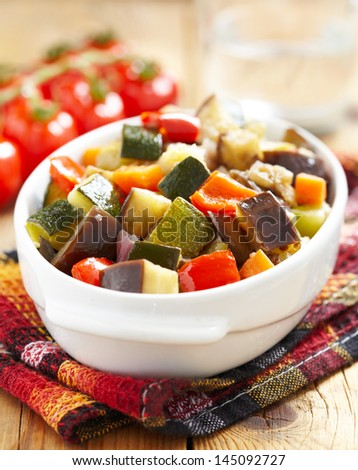 vegetable ratatouille on wooden table - stock photo