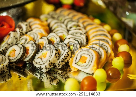Vegetable rolls on large plate on festive table. - stock photo