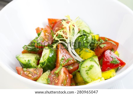 vegetable salad cucumber tomato pepper with sunflower oil - stock photo