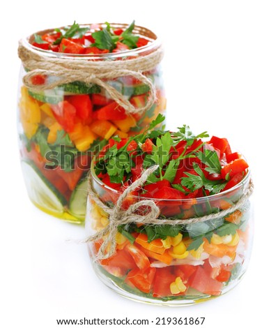 Vegetable salad in glass jars, isolated on white - stock photo