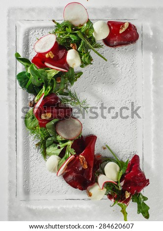Vegetable salad on glass plate. White background - stock photo