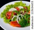 Vegetable salad on white dish. - stock photo