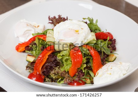 vegetable salad with poached egg - stock photo