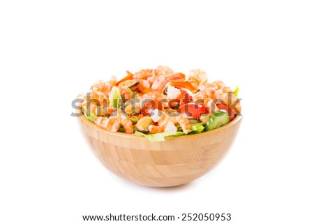 Vegetable salad with shrimp and mussels on a white background. - stock photo