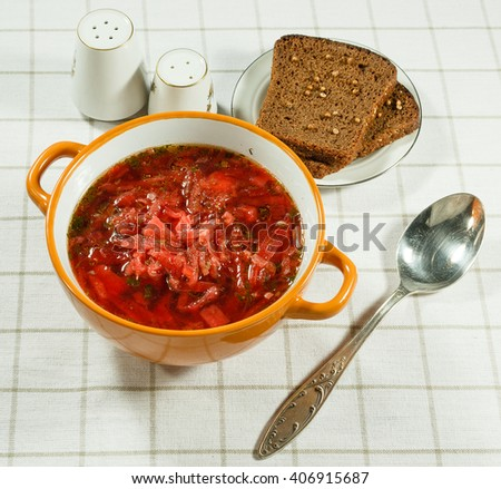 Vegetable soup (borscht).  Traditional Ukrainian soup with fresh vegetables with sour cream. Serving on a white tablecloth. - stock photo