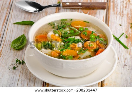 Vegetable soup in a white bowl. Selective focus - stock photo