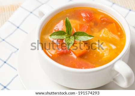 Vegetable soup made from tomato potato and carrot - stock photo